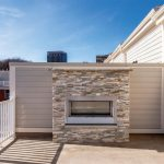 Picture of the Sunrise Square townhome's rooftop terrace with gas fireplace